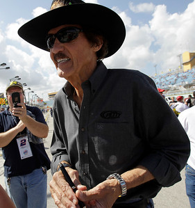 Richard Petty walks toward the track before the start of the Ford 400 auto race on Sunday Nov. 21, 2010, in Homestead, Fla. (AP Photo/Lynne Sladky)