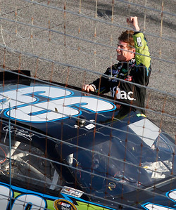 NASCAR driver Carl Edwards celebrates  after winning the Ford 400 auto race, Sunday, Nov. 21, 2010, at Homestead-Miami Speedway in Homestead, Fla. (AP Photo/Wilfredo Lee)