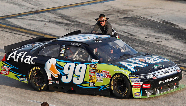 NASCAR legend Richard Petty congratulates driver Carl Edwards in the No. 99 Aflac Ford after Edwards won the Ford 400 auto race, Sunday, Nov. 21, 2010, at Homestead-Miami Speedway in Homestead, Fla. (AP Photo/Wilfredo Lee)