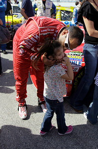 NASCAR driver Juan Pablo Montoya kisses his daughter, Paulina, before the start of the Ford 400 auto race on Sunday, Nov. 21, 2010, in Homestead, Fla.(AP Photo/J Pat Carter)