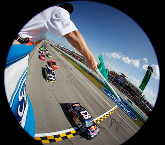 In this image taken with a fisheye lens, the the green flag is waved as pole sitter Kasey Kahne  starts the Ford 400 auto race, Sunday Nov. 21, 2010 in Homestead, Fla. (AP Photo/Todd Warshaw, pool)