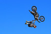 Backflip Superman Something, Kansas City KS<br /> <br /> Shots from freestyle motocross event being held in the parking lot at Kansas Motor Speedway.  These guys were crazy good, jumping 75 feet, landing on a rubber landing ramp, and then right on to the asphalt to do it all over again.