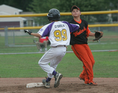 Avon's Donnie O'Brien steals second base against Wheelersburg during Little League play at Elyria East. photo by Chuck Humel