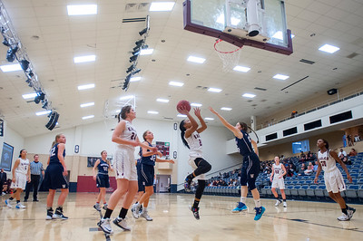 Danyale Thomas (20) splits the Waterford High School's defenders for the easy layup for Layton Christian Academy on Thursday January 26, 2017.