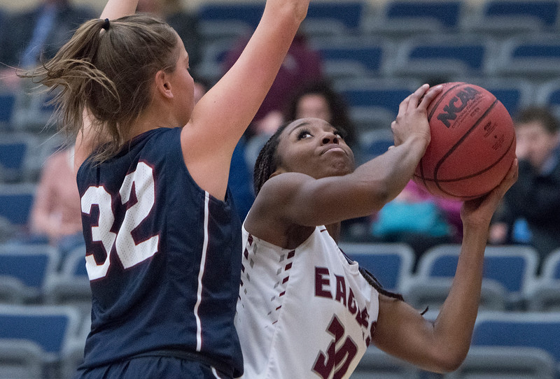 Jada Wyms (30) tries to shoot around Jamie Francis (32) during the matchup between Waterford High School and Layton Christian Academy on Thursday January 26, 2017.
