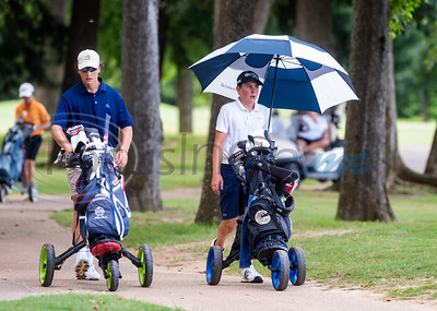 Davis Habermehl of Tyler and Judson Hays of Argyle walk to their next tee during the Azalea Trail Junior Golf tournament held at Hollytree Country Club in Tyler on Monday, July 20, 2020.