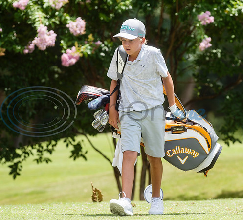 Shea Sethre-Brink of Dripping Springs walks to the next tee during the Azalea Trail Junior Golf tournament held at Hollytree Country Club in Tyler on Monday, July 20, 2020.