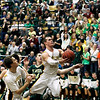 Record-Eagle/Jan-Michael Stump<br /> Traverse City Central guard Ryan Verschuren (22) drives to the basket in the first quarter of Thursday's game.