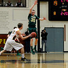 Record-Eagle/Jan-Michael Stump<br /> Traverse City West guard Graeme Placek (30) defends a pass by  Traverse City Central forward Colin Lesoski (14).