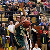 Record-Eagle/Jan-Michael Stump<br /> Traverse City West guard Donny Cizek (11) gets fouled on his way to the basket by Traverse City Central center Tyler Gildersleeve (54) in the third quarter of Thursday's game.