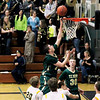 Record-Eagle/Jan-Michael Stump<br /> Traverse City West forward Trevor Commissaris (24) scores on a layup in the second quarter of Thursday's win over Traverse City Central.