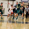 Record-Eagle/Jan-Michael Stump<br /> Traverse City Central forward Ethan Pilarski (20) drives past Traverse City West guards Graeme Placek (30) and Jeremiah Williams (12) in the first half of Thursday's game.