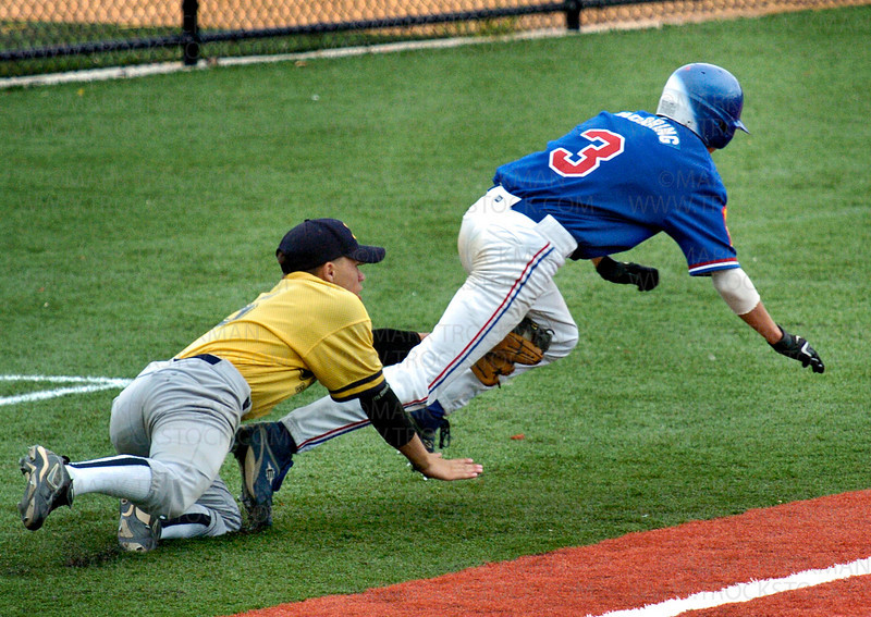 Excelsior's Matt Noerring is run down and tagged out by Bloomington Gold third baseman Matt Santiago Thursday, July 24 at Veterans Field.  Excelsior beat Bloomington 7-3.