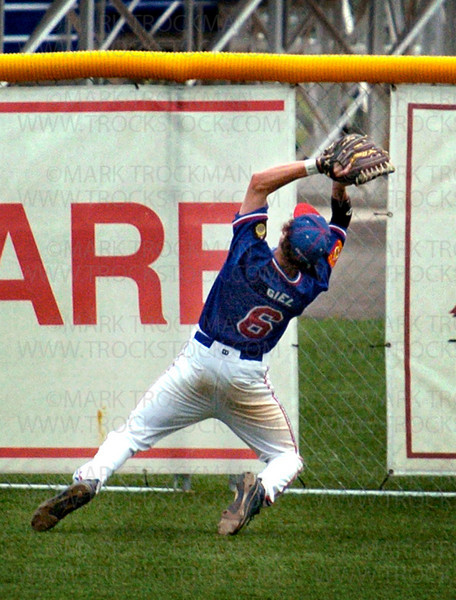 Excelsior center fielder Paul Giel acrobatically catches a long fly ball over his shoulder in game one of the South Hennepin League playoffs Thursday, July 24 at Veterans Field.  The Excelsior legion baseball team defeated Bloomington Gold 7-3.