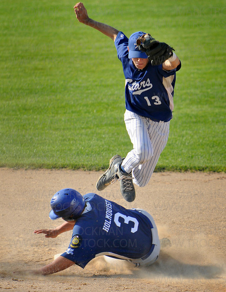 Wayzata's Trent Holmquist, bottom, trips up Academy Stars Cole Frechette after being tagged out at second after Dylan Kent's bunt in the fourth inning at Johnson Park in New Ulm July 31.