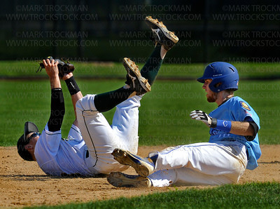 The Flyers Andy Wicklund, right, sends the Edina 2nd baseman onto his back after being tagged out in a rough exchange in the 2nd inning of their District 10 American Legion Tournament game Sunday, July 29, at Red Haddox Field in Bloomington.  Hopkins lost to Edina 7-3.