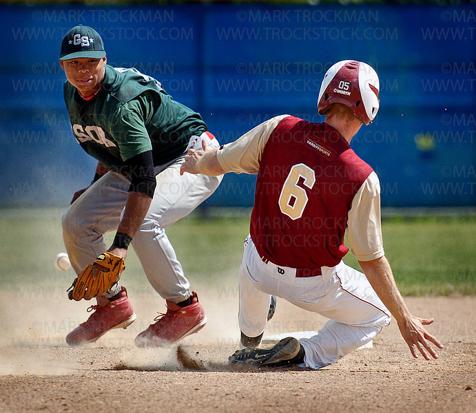 The Redhawks Chris Shearer successfully steals second base as Edina's shortstop can't get the ball in time for a tag in the second inning of NWS' 3-2 win against the ESOX Sunday at Wayzata High School.