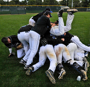 The Minnetonka Millers pile on each other in center field after beating the Minneapolis Angels 11-5 to clinch the 2012 Minnesota Class-A Amateur State Baseball Tournament Sunday, August 19, in Bloomington.