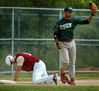 The Redhawks Travis Johnson stares dejected at third base after being tagged out to end the first game between the Edina ESOX and the Northwestern Redhawks Sunday, July 13 at Wayzata High School.  Edina won the game 7-1 Sunday.