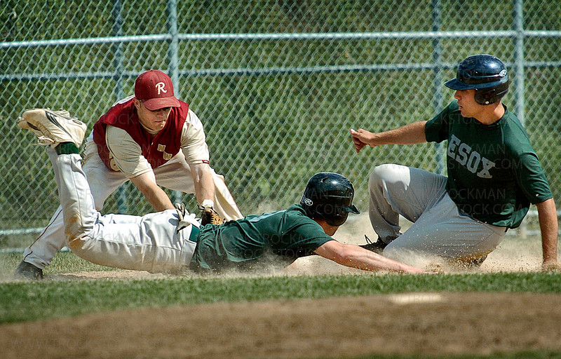 Redhawks third baseman Robbie Smith, top, tags out Edina's Dan Bissonnette after he was caught in a third base-line rundown in the third inning.  The Redhawks went on to win the second game of their double header against the ESOX 3-2 Sunday, July 13 at Wayzata High School in Plymouth, Minn.