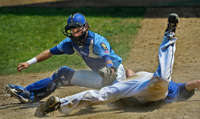 Hopkins catcher Matt Sinderson, left, tags out an Eastview baserunner in the 5th inning of the Flyers Minnesota American Legion Tournament 5-4 win at Chanhassen High School Friday, August 3, 2012.