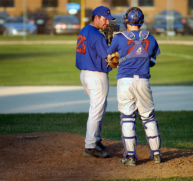 Hopkins Berries pitcher Anders Schmidt, left, confers with catcher Ryan Cohn on the mound Thursday, June 26 at Big Willow Park in Minnetonka.  The Berries defeated the Bloomington Bandits  4-3.