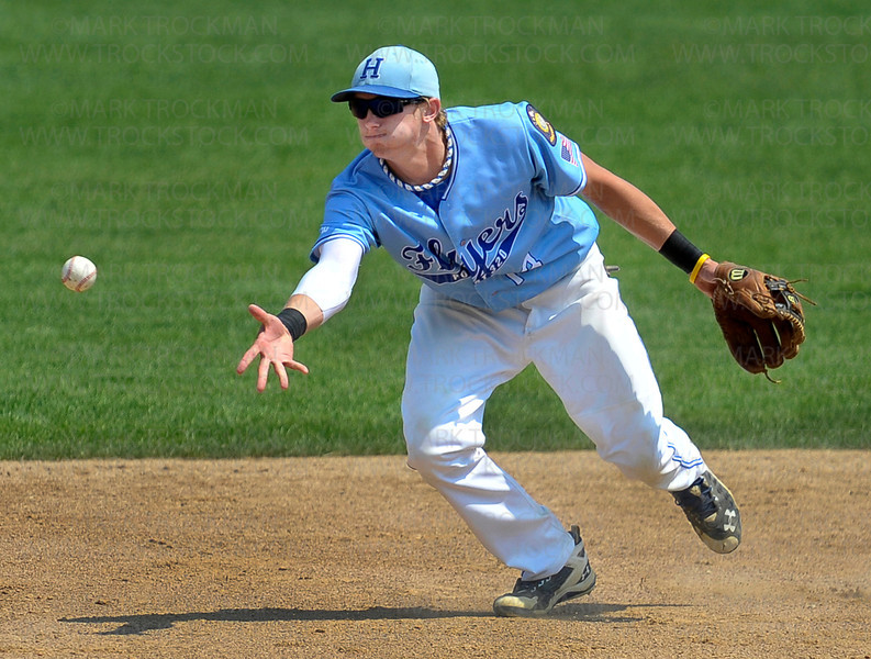 Hopkins 2nd baseman Kyle Dalton tosses a grounder to 2nd base helping to turn a double play against Eastview at Chanhassen High School Friday, August 3, during the Flyers 5-4, first-round, Minnesota American Legion Tournament win.