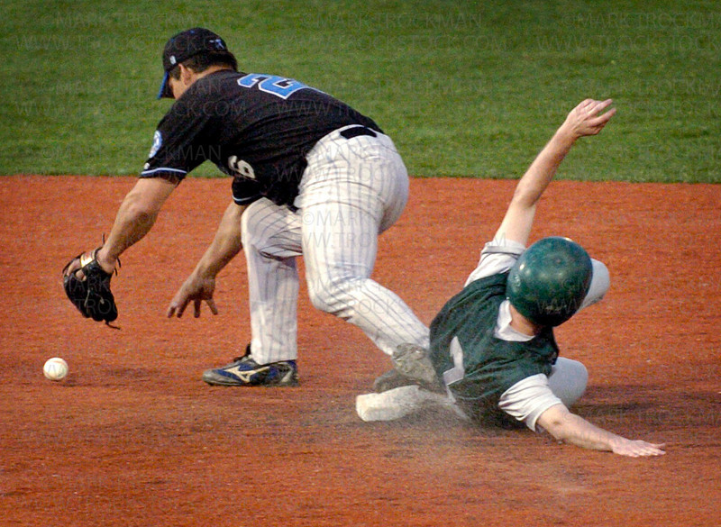 Minnetonka Millers 2nd baseman Ryan Dalum, left, reaches for the ball while an Edina E-Sox player successfully steals 2nd base Tuesday, June 10 at Veteran's Field at Minnetonka High School. The Millers beat Edina 4-0.