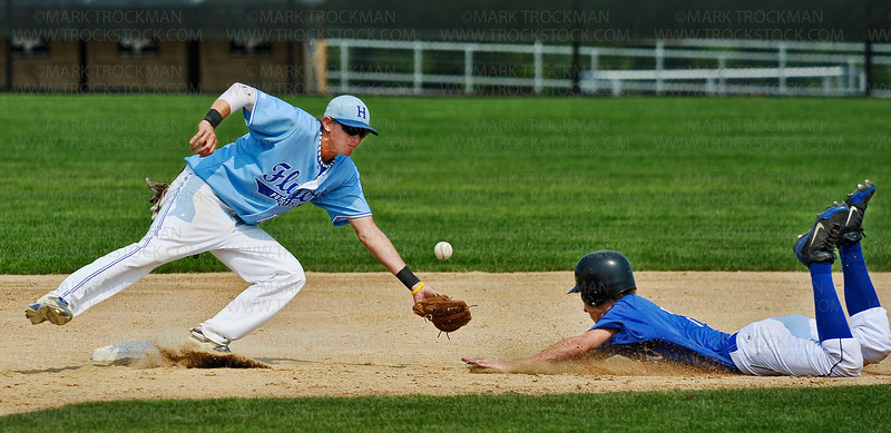 Hopkins 2nd baseman Kyle Dalton, left, misses the throw from home, allowing the Eastview runner to steal 2nd base in the 6th inning of the Flyers 5-4 Minnesota American Legion Tournament win Friday, August 3, at Chanhassen High School.