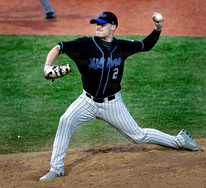 Minnetonka Millers pitcher Brandon Broxey throws against the Edina E-Sox in late-game action on Veteran's Field Tuesday, June 10 at Minnetonka High School.  The Millers beat Edina 4-0.
