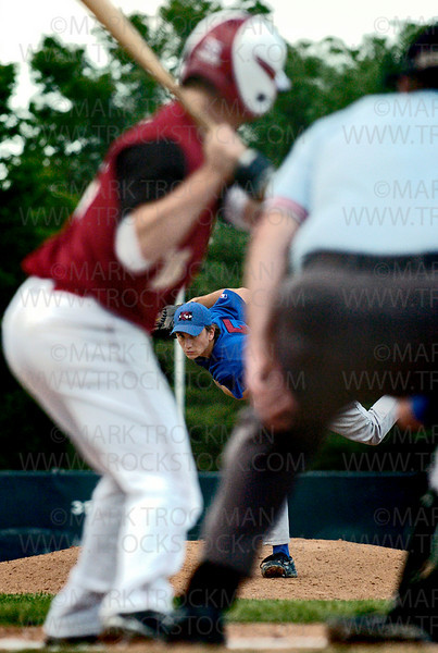 Hopkins Berries pitcher Travis Adams, center, hurls one toward home plate against the NW Redhawks at Big Willow Park in Minnetonka Thursday, June 12.  Hopkins beat the Redhawks 7-1.