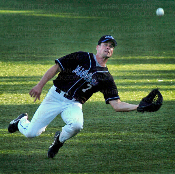 Miller's right fielder Tony Kurtz makes a diving catch for an out in the first inning of Minnetonka's 11-0 trouncing of the Westside Bombers at Veteran's Field Thursday, June 19 in Minnetonka.