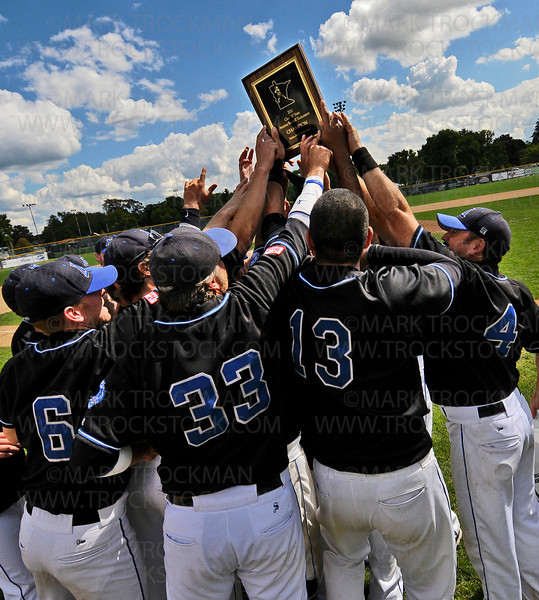 The Minnetonka Millers lift their first place trophy after beating the Minneapolis Angels 11-5 to clinch the 2012 Minnesota Class-A Amateur State Baseball Tournament Sunday, August 19, in Bloomington.
