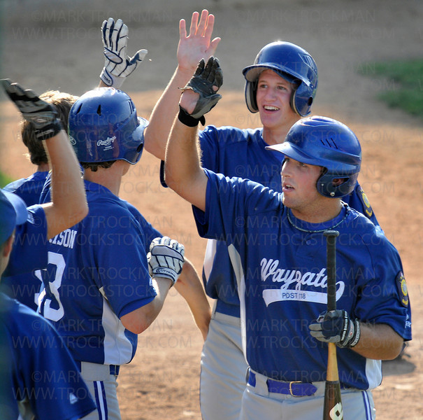 Congratulations are in order after Wayzata ties the score 10-10 on Zach Trygstad's triple at Johnson Park in New Ulm Friday, July 31.