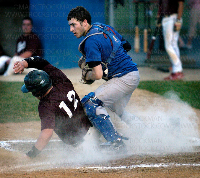 Berries catcher Ryan Cohn, right, tags out a Bandits base runner at home plate Thursday, June 26 at Big Willow Park in Minnetonka.  Hopkins beat Bloomington 4-3.