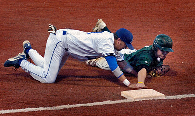 A good call.  Minnetonka Millers 1st baseman Steve Schmitz tags out the Shamrocks Darrin Hubbard on a pick-off in the 6th inning.  The Shamrocks argued the call but it was not overturned.
