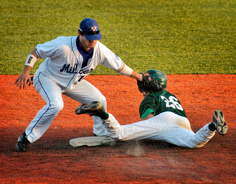 The Millers Adam Goethke, left, tags the Shamrocks Chris Bullis at 2nd base too late to stop Bullis' steal at Veterans Field Saturday, Aug. 9 in Minnetonka.