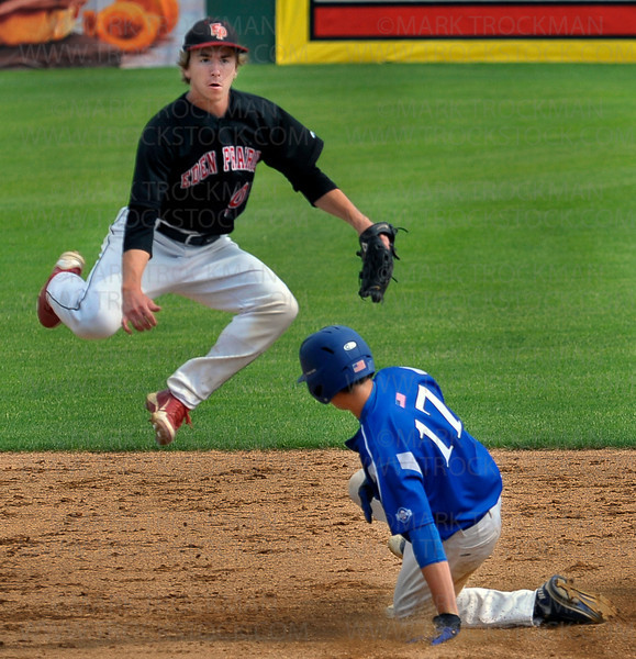 Hopkins senior Jack Deutsch (17) is forced out at second by Eagles shortstop Derek Soderberg during the 3A baseball state quarterfinal Friday, June 15, at Midway Stadium in St. Paul.  Eden Prairie blanked the Royals 4-0.