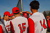 #10 Elvin Medina gets helmet taps from team mates after home run. Photo by Kathy Leistner