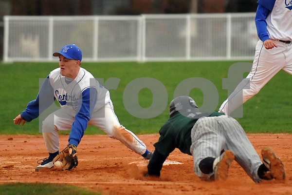 1621 #21 VSCHS 2nd Baseman Mike Daly attempts a tag of Elmont HS #17 Sebastian Clerge.  VSCHS vs Elmont HS. April 7th, 2009. Photo by Kathy Leistner.