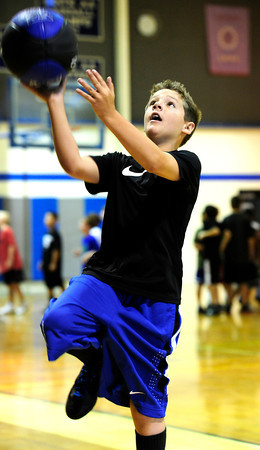 "Gavin Poxson drives to the hoop during layup practice during basketball camp at Broomfield High School on Monday June 4, 2012<br /> For more photos go to  <a href=""http://www.broomfieldenterprise.com"">http://www.broomfieldenterprise.com</a> <br /> Photos by Paul Aiken<br /> <br /> BROOMFIELD HIGH BASKETBALL CAMP"