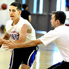 "Van Lindenmann works a pass around camp coach and BHS player Parker Ericson during basketball camp at Broomfield High School on Monday June 4, 2012<br /> For more photos go to  <a href=""http://www.broomfieldenterprise.com"">http://www.broomfieldenterprise.com</a> <br /> Photos by Paul Aiken<br /> <br /> BROOMFIELD HIGH BASKETBALL CAMP"