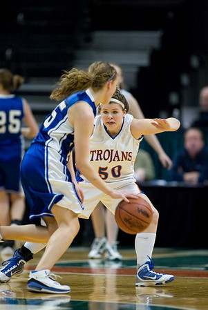 Record-Eagle/Jan-Michael Stump<br /> Central Lake's Tasha Crouse (50) defends Adrian Lenawee Christian's LeAnn Porter(15) in the state Class D semifinals Thursday at the Bresling Student Events Center in East Lansing.