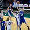 Record-Eagle/Jan-Michael Stump<br /> Adrian Lenawee Christian's Heidi Stultz (33) shoots over Central Lake's Tasha Crouse (50) in the state Class D semifinals Thursday at the Bresling Student Events Center in East Lansing.