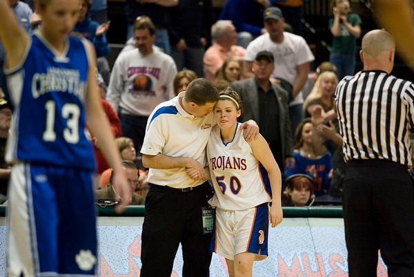 Record-Eagle/Jan-Michael Stump<br /> Central Lake coach Al Becker talks to Sheila Crouse (50) near the end of Thursday's loss to Adrian Lenawee Christian in the state Class D semifinals at the Bresling Student Events Center in East Lansing.