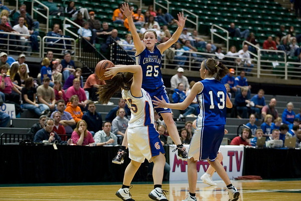 Record-Eagle/Jan-Michael Stump<br /> Central Lake's Sheila Crouse (33) looks for an outlet past Adrian Lenawee Christian's Tenille Marowelli (25) and Brooklyn Wingfield (13) in the state Class D semifinals Thursday at the Bresling Student Events Center in East Lansing.