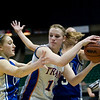 Record-Eagle/Jan-Michael Stump<br /> Central Lake's Jennifer Corbett (13) gets trapped by Adrian Lenawee Christian's LeAnn Porter (15) and Brooklyn Wingfield (13) in the state Class D semifinals Thursday at the Bresling Student Events Center in East Lansing.