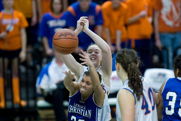 Record-Eagle/Jan-Michael Stump<br /> Central Lake's Heidi Hicks (2) fights for a rebound with Adrian Lenawee Christian's Courtney Dietrich (23) in the state Class D semifinals Thursday at the Bresling Student Events Center in East Lansing.