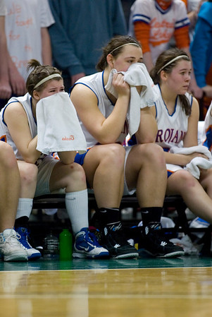 Record-Eagle/Jan-Michael Stump<br /> Central Lake's Tasha Crouse (50), Jasmine Hines (40) and Sheila Crouse (33) watch as Adrian Lenawee Christian pulls away after the three fouled out in the state Class D semifinals Thursday at the Bresling Student Events Center in East Lansing.