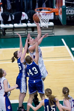 Record-Eagle/Jan-Michael Stump<br /> Central Lake's Jasmine Hines (40) scores over Adrian Lenawee Christian's Tenille Marowelli (25) and Andrea Sebby (43) in the state Class D semifinals Thursday at the Bresling Student Events Center in East Lansing.